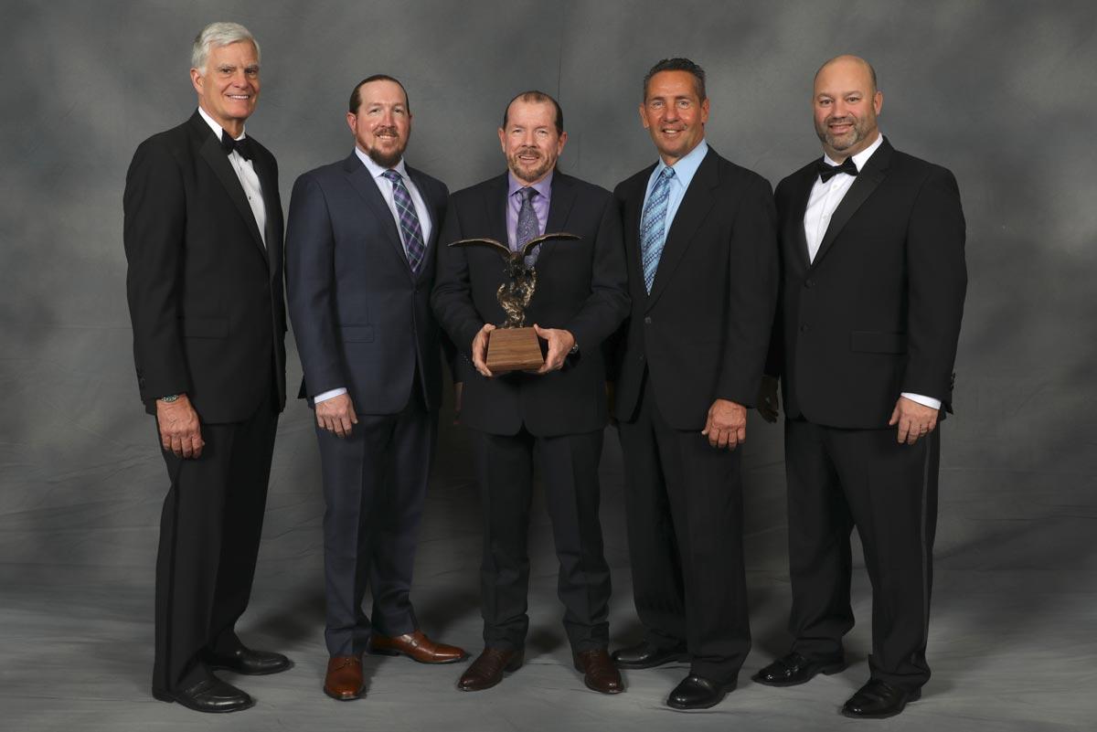 Superior Services receiving an award